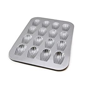 Usa pan bakeware madeleine, warp resistant nonstick baking pan, made in the usa from aluminized steel, 16-well, silver 1 perfect for delicious french madeleines that bake evenly and taste great; heavy gauge aluminized steel that is commercial grade usa pan baking pans feature americoat which promotes quick release of baked-goods plus fast and easy clean up; wash with hot water, mild soap and gentle scrub brush or sponge nonstick americoat coating - a patented silicone coating which is ptfe, pfoa and bpa free - provides quick and easy release of all baked-goods and minimal easy clean up