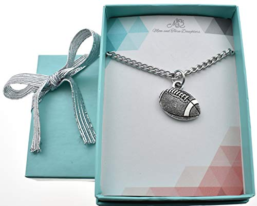 - Football charm pendant in silver pewter on an 18