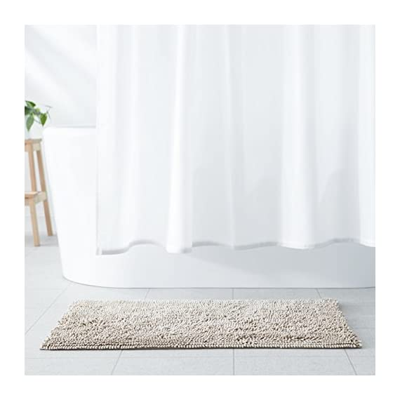 "AmazonBasics Non-Slip Microfiber Shag Bathroom Rug Mat, 21"" x 34"", Beige - Microfiber shag bath rug in Beige provides a comfortably plush place to stand and helps keep floors dry Absorbent, plush tufts across the entire surface soak up water fast; dries quickly for supreme comfort from one use to the next Non-slip backing keeps the rug securely in place, even when wet, for added safety - bathroom-linens, bathroom, bath-mats - 41OHILEeZHL. SS570  -"