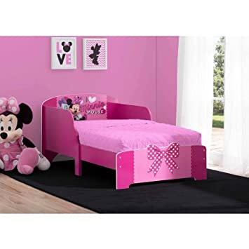 Disney Minnie Mouse Wood Toddler Bed Features 2 Attached Guardrails