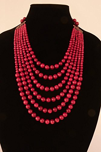 Success Beads - A six strand dark red coral bead necklace with antique copper clas
