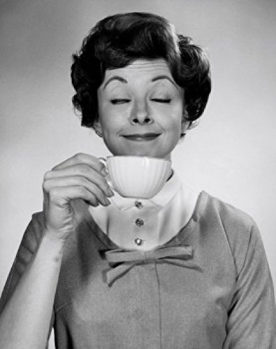Portrait of young woman smelling cup of tea Poster Print (18 x 24)