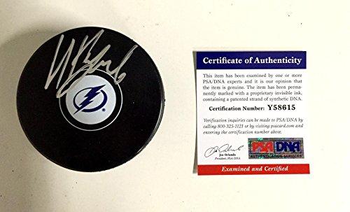Tampa Bay Lightning Locker Room (Nikita Kucherov Tampa Bay Lightning Signed Puck - Y58615 - PSA/DNA Certified - Autographed NHL Pucks)