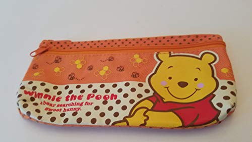 (Disney babyface smiling Winnie the Pooh A bear searching for sweet honey small half orange and tan with little brown polka dots with honeycombs and bees carrying pouch: approx 3 1/2' X 6 1/2