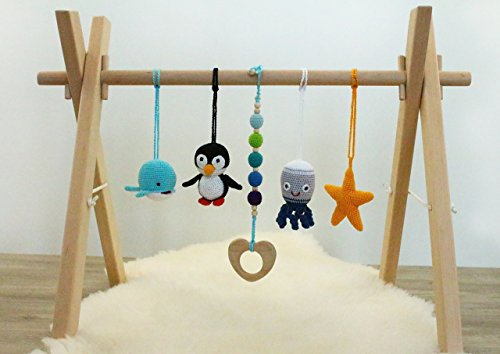 Nautical baby gym. Wooden baby gym with 4 crochet ocean animal rattles and a wooden teething toy. Handmade in eastern Europe.