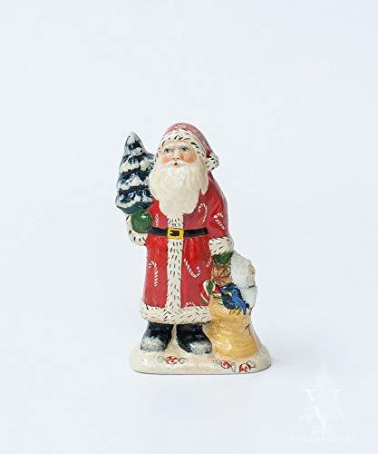Vaillancourt Folk Art Snowsuit Baby and Candies Santa]()