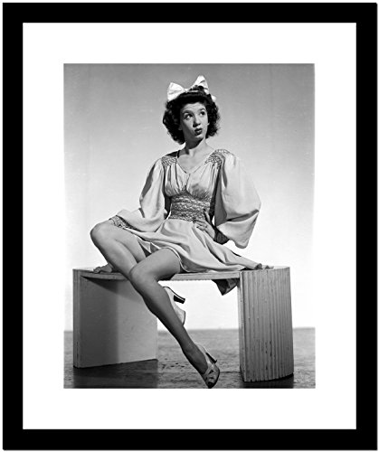 Jane Withers Seated on a Table in White Silk V-Neck Gathered Bodice with Bell Long Sleeve Dress with Knees Bent and Left Hand on the Waist Premium Art Print (Framed 8x10)