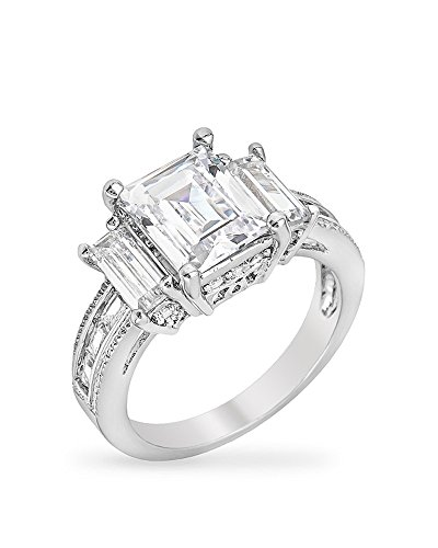 Rhodium Plated Celebrity Engagement Ring with Large Emerald Cut CZ Triplet with More Round Cut CZ Size 5 from Kate Bissett