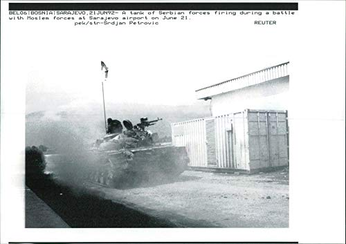 Vintage photo of A tank of serbian forces firing during a battle.