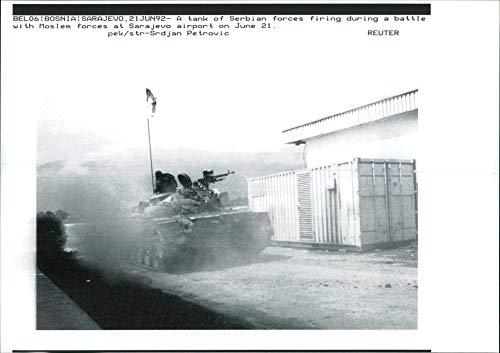 Tank Firing Battle (Vintage photo of A tank of serbian forces firing during a battle.)
