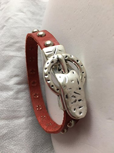 Red leather bracelet with silver colored and studs and belt buckle magnetic closure