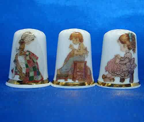 SET OF THREE MINIATURE HOUSE STYLE WEAVING FINE CHINA THIMBLES