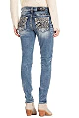 Skinny jean is styled with embellished and embroidered native-inspired design on back pockets, other details include mid-rise, fading, whiskering, contrast stitching, black logo patch, and silver hardware.