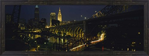 Arch bridge and buildings lit up at night, Cleveland, Ohio, USA by Panoramic Images Framed Art Print Wall Picture, Espresso Brown Frame, 38 x 14 inches