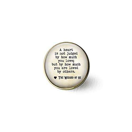 (stap Wizard of Oz Quote A heart is not judged by how much you love; but by how much you are loved by others - Ruby Slippers Charm brooch)