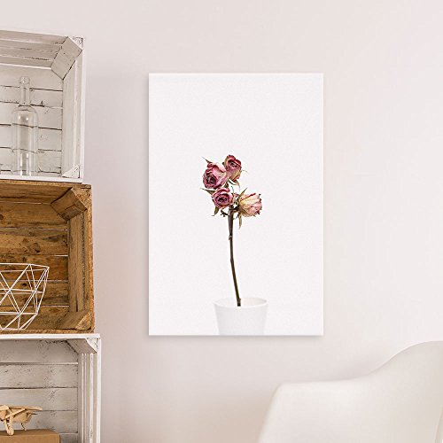 A Dried Rose in a White Porcelian Vase Gallery