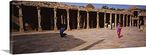 Tourist at the mosque, Quwwat-Ul-Islam Mosque, Qutb Complex, New Delhi, India Gallery-Wrapped Canvas