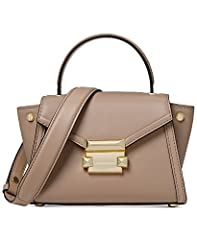 It doesn't get any more timeless than the push-lock detailed MICHAEL Michael Kors Mini Messenger crafted from luxe leather.