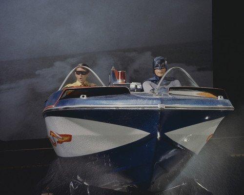 Batman Adam West Burt Ward in bat speed boat on tv set against backdrop 8x10 Promotional ()