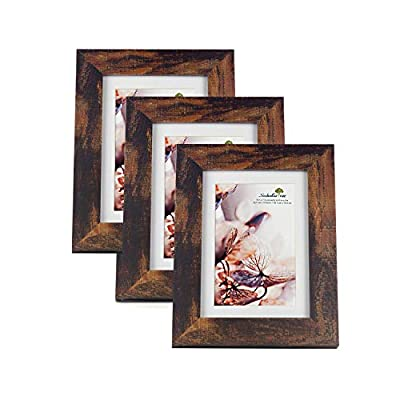 Scholartree Wooden Brown 5x7 Picture Frame 3 Set in 1 Pack or 5x7 Frame or 11x14 Photo Frame - ELEGANT DESIGN: 5x7 Picture Frame made to display 5x7 inches pictures without Mat or 4x6 inches photos with Mat. The picture frame is designed with hooks and brackets that can be displayed on the table and wall. HIGHEST QUALITY: 5x7 frames are made of MDF(a kind of hard wood) and real inorganic glass. It make the frame strong and the real glass has high transparency. The frame includes built-in metal tabs for easy access to display your photos, cards and memories. ATTRACTIVE LOOK: White coloured mat keeps photos and artwork looking great for years. Turn your portraits, artful prints and everyday shots into a spectacular display. The actual mat opening is designed to hold a 4x6 inch photo in place. We recommend taping the photo to the back of the mat. - picture-frames, bedroom-decor, bedroom - 41PvJMB5yJL. SS400  -