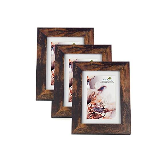 Scholartree Wooden Brown 5x7 Picture Frame 3 Set in 1 Pack or 5x7 Frame or 11x14 Photo Frame - ELEGANT DESIGN: 5x7 Picture Frame made to display 5x7 inches pictures without Mat or 4x6 inches photos with Mat. The picture frame is designed with hooks and brackets that can be displayed on the table and wall. HIGHEST QUALITY: 5x7 frames are made of MDF(a kind of hard wood) and real inorganic glass. It make the frame strong and the real glass has high transparency. The frame includes built-in metal tabs for easy access to display your photos, cards and memories. ATTRACTIVE LOOK: White coloured mat keeps photos and artwork looking great for years. Turn your portraits, artful prints and everyday shots into a spectacular display. The actual mat opening is designed to hold a 4x6 inch photo in place. We recommend taping the photo to the back of the mat. - picture-frames, bedroom-decor, bedroom - 41PvJMB5yJL. SS570  -