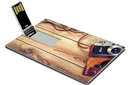 Luxlady 32GB USB Flash Drive 2.0 Memory Stick Credit Card Size Old retro camera on wooden table background Copy space Top view IMAGE 31577809 from Luxlady