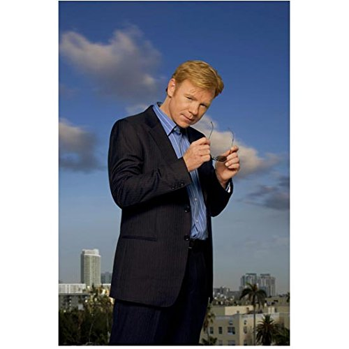 CSI: Miami 8inch x 10inch Photo David Caruso Putting On/Taking Off Sunglasses Blue Sky ()