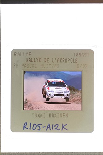 slides-photo-of-tommi-makinen-driving-the-car-during-the-acropolis-rally
