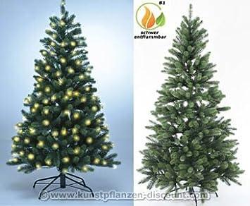 Kunstlicher weihnachtsbaum mit deko und beleuchtung
