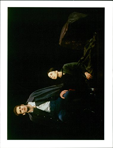 Vintage photo of Jere shea left and donna murphy act in a scene from the new york broadway musical passion.