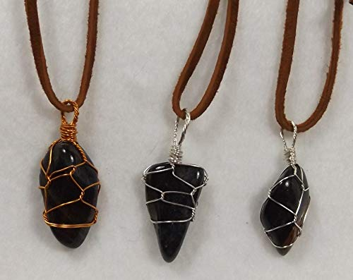 Tiger Eye Blue Gemstone, Wire Wrapped in a variety of color wires and is on an 18