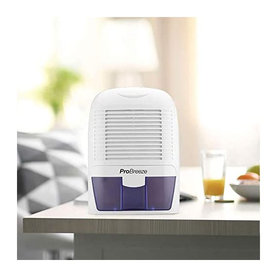 Pro Breeze Electric Mini Dehumidifier, 2200 Cubic Feet (250 sq ft), Compact and Portable for High Humidity in Home, Kitchen, Bedroom, Basement, Caravan, Office, Garage 5 SMALL & COMPACT - Lightweight, Compact and Portable Ð Capable of removing up to 18 ounces of water per day with a 52-ounce water tank capacity. Ideal for rooms up to 2200 cubic feet (220 sq ft) AUTO SHUT OFF: When full the dehumidifier will automatically shut off and the LED light will turn-on indicating the water tank needs draining. Simply empty the water tank and place it back into the dehumidifier ULTRA-QUIET & EFFICIENT: Built-in Thermo-Electric Cooling Technology (Peltier) operates without a compressor meaning whisper quiet operation in bedrooms, bathrooms and offices