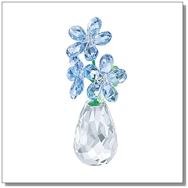 A Crystal Forget Me Not Flower In A Vase Blue Crystal Sky