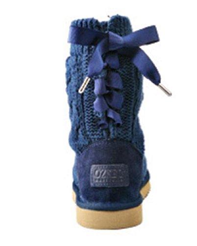 La mariposa de las mujeres del invierno atan para arriba los cargadores de pieles antideslizantes de la zalea Las lanas que tejen los cargadores de la nieve treasure blue
