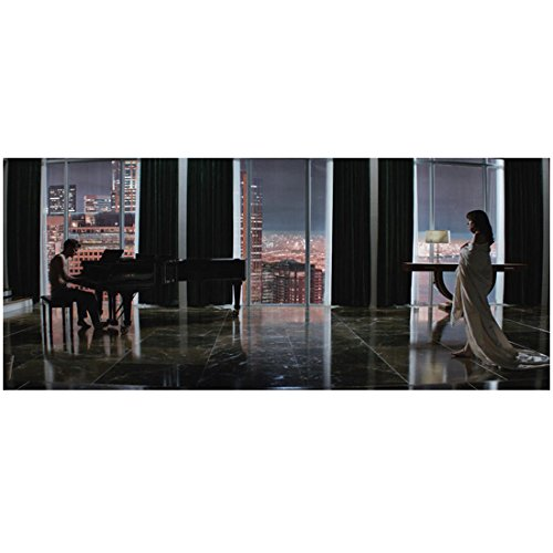 - Fifty Shades of Grey Jamie Dornan as Christian Grey Playing Piano and Dakota Johnson as Anastasia Steele Wrapped in Blanket Walking Across Room with Cityscape Background 8 x 10 Photo