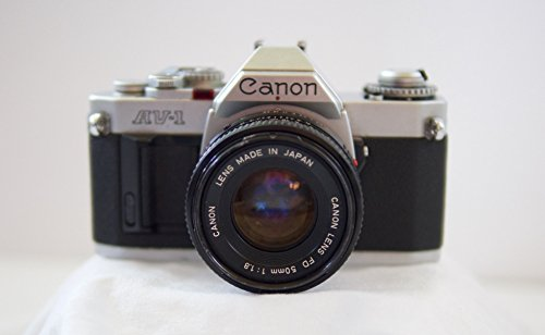 - Canon AV-1 35mm SLR Camera with Canon FD 50mm 1:1.8 Lens