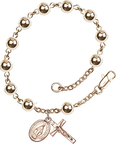 F A Dumont 14 Karat Gold Rosary Bracelet Features 6mm 14 Karat Gold Round Beads. The Crucifix Measures 5/8 x 1/4.