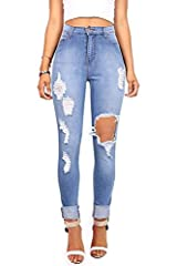 High waisted skinnys in a medium denim wash and distressing down the front with a hole on the left knee. Tradition 5 pocket jeans with a zip fly and button closure.