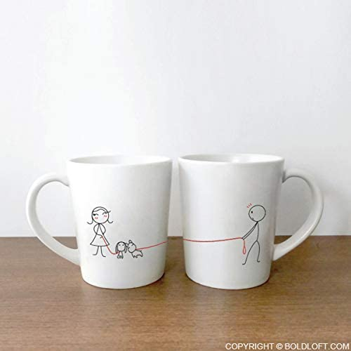 Image a two white couple mugs with cute designs.