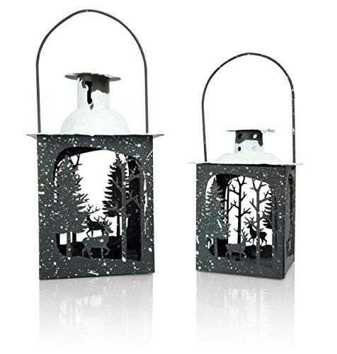 - BANBERRY DESIGNS Rustic Christmas Décor Lantern Set – Set of 2 - Small and Medium Metal Lanterns - Winter Scene with Deer – Glittery Snow Tops - Farmhouse Style Lanterns