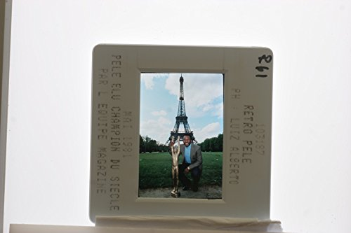 Slides photo of Brazilian Football legend Pel233; posing in front of Eiffel Tower with a trophy which he getting from France in 1981 as represent him champion of the century - France Trophy