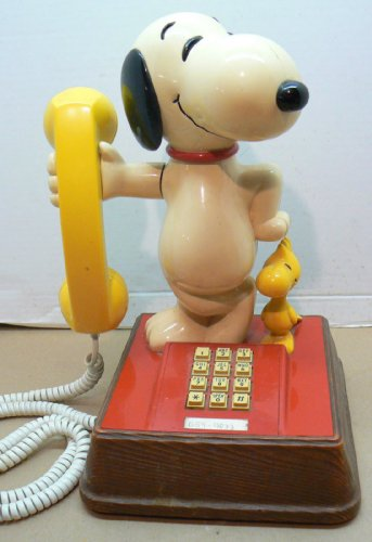 - SNOOPY AND WOODSTOCK PHONE PUSH BUTTON DATED 1976