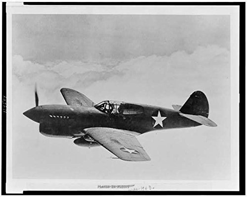 Photo: Aerial view of P-40 single-engine fighter plane in flight,World War II,WWII,1943