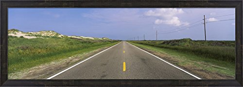 Road passing through a landscape, North Carolina Highway 12, Cape Hatteras National Seashore, Outer Banks, North Carolina, USA by Panoramic Images Framed Art Print Wall Picture, Espresso Brown Frame, -