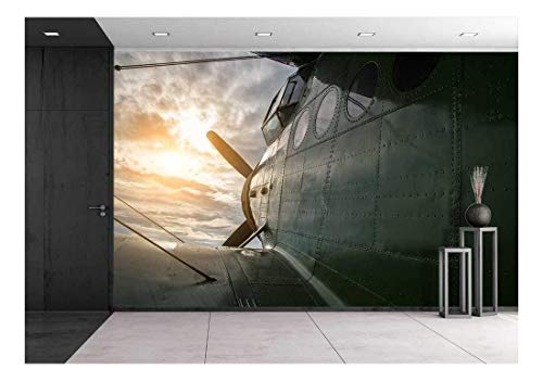 wall26 - Old Aircraft Flying in a Cloudy Sky by Sunset - Removable Wall Mural | Self-Adhesive Large Wallpaper - 66x96 inches
