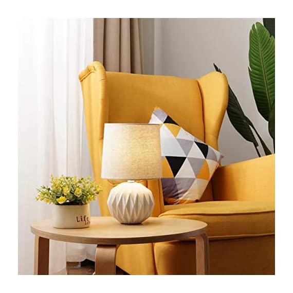 """Tayanuc Small Geometric Ceramic Bedside Nightstand Table Lamp, White Textured Desk Lamp Linen Drum Fabric Shade for… - Ceramic Table Lamp: This white ceramic table lamp shaped like a pineapple takes a fresh twist with textural geometric ceramic body. The solid color allows the plentiful texture and modern silhouette to truly shine and adds a hint of glam to nightstand. Excellent gifts for the coming Thanksgiving Day. Materials: The inimitable desk lamp will turn heads with its smooth textured curves balanced on a white ceramic base. It is paired with beige linen drum fabric shade that casts an ambient glow. Dimensions: 7.5"""" D x 12.6"""" H. - lamps, bedroom-decor, bedroom - 41RLRlVlODL. SS570  -"""