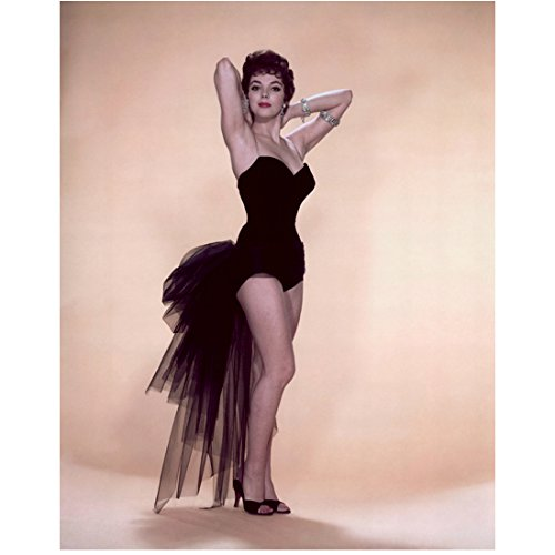 Joan Collins 8inch x 10inch Photo Dynasty The Flinstones in Viva Rock Vegas Empire of the Ants Hands Behind Head Flouncy Tail on Skimpy Costume kn]()