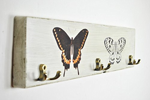 Wooden coat rack with butterfly prints