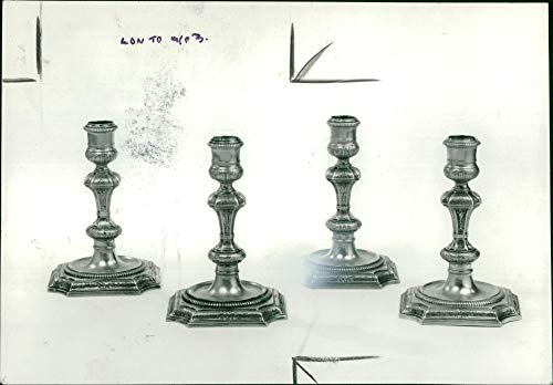 (Vintage photo of Two of a set of George I silver-gilt table candlesticks.)