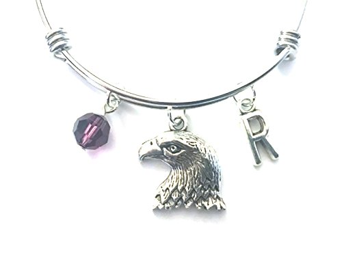 Eagle themed personalized bangle bracelet. Antique silver charms and a genuine Swarovski birthstone colored element.